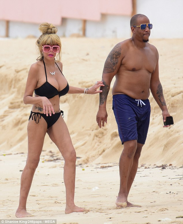 Wendy Williams shows off her surgically enhanced body in a bikini