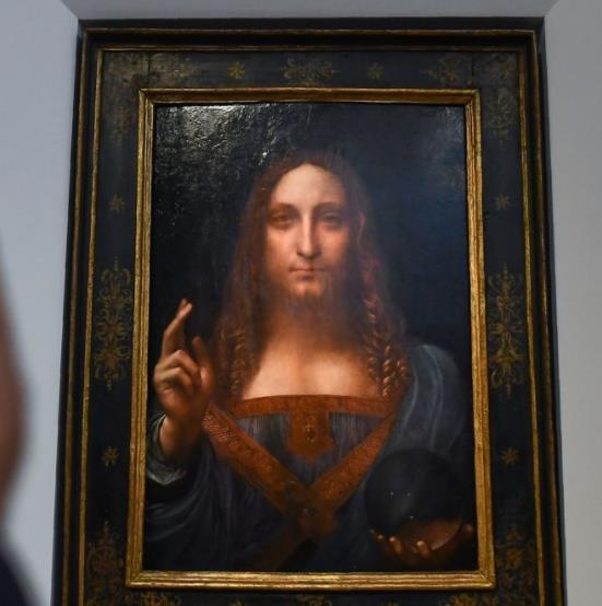 "Photo of Leonardo da Vinci's ""Salvator Mundi"" becomes the most expensive painting to ever sell at auction for $450.3 million"