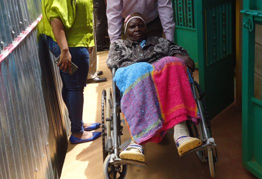 Photo of 73-year-old Kenyan woman arrives court in wheelchair to divorce her husband of 55-years