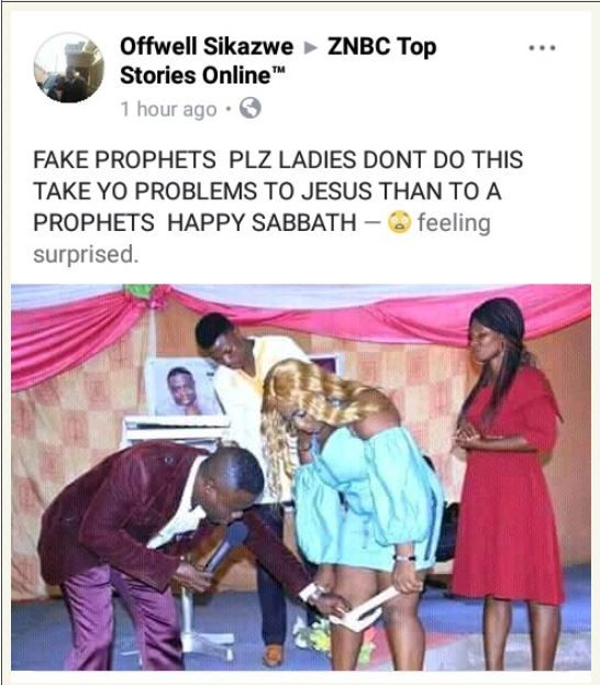 Photo of a 'Zambian prophet' removing a lady's underwear, Photo of a 'Zambian prophet' removing a lady's underwear in church goes viral, Premium News24