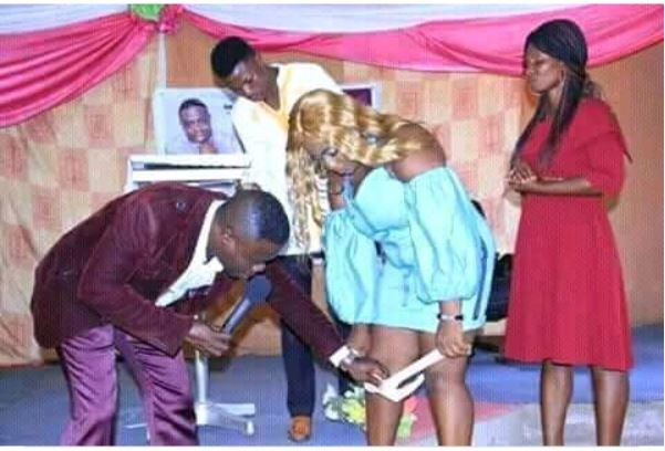 Photo of Photo of a 'Zambian prophet' removing a lady's underwear in church goes viral