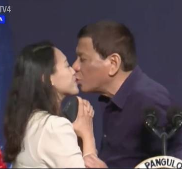 Photo of Philippine president Rodrigo Duterte sparks outrage for kissing woman on stage (video)