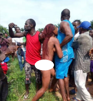 Photo of Married woman caught having sex with ex, who is also married, are paraded naked and beaten in Enugu (photos)