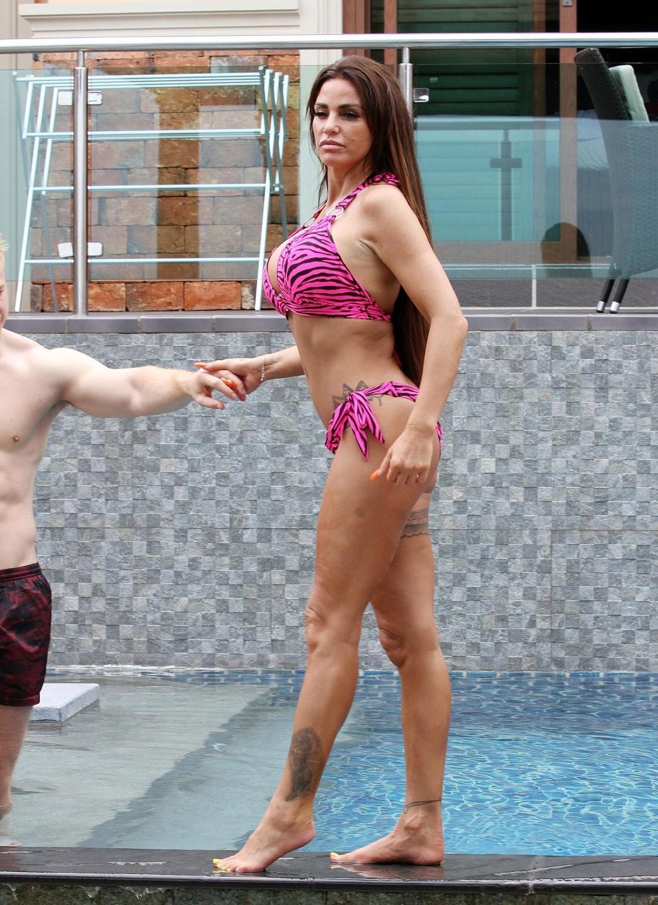 Katie Price, Katie Price flaunts her curves  as she snogs boyfriend Kris Boyson poolside in Thailand