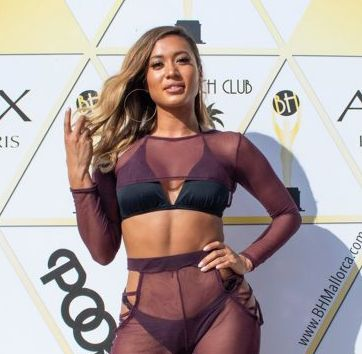 Love Island's Kaz Crossley shows off enviable physique in see-through co-ord as she attends pool party in Mallorca