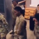 Video of a female Nigerian-born US soldier teaching other female soldiers