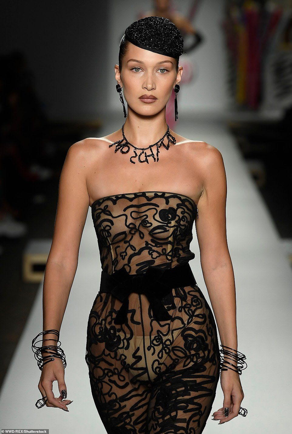Braless photos of Bella Hadid at bonkers Moschino MFW show