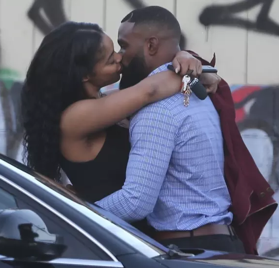 UFC Champion Tyron Woodley caught cheating on his wife and kissing a woman in public