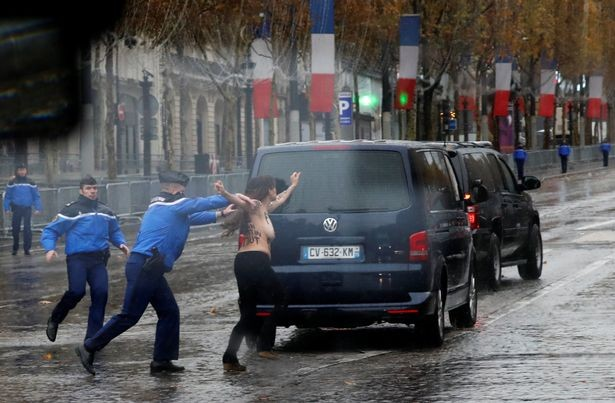 Photo of Topless female protester runs at President Trump's motorcade in Paris (photos/video)