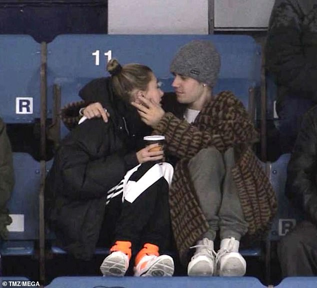 Photo of Justin Bieber and wife Hailey Baldwin cuddle up at a junior hockey game in Canada (Photos)
