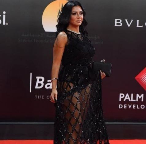 Photo of Egyptian actress, Rania Youssef to face trial for wearing a revealing dress to the Cairo Film Festival