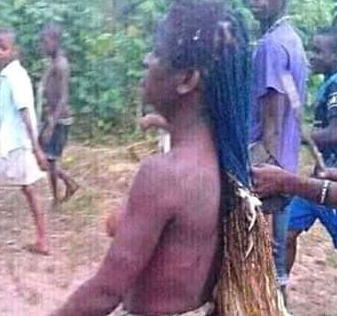 residents strip lady naked over N2000 stolen chicken (photos)