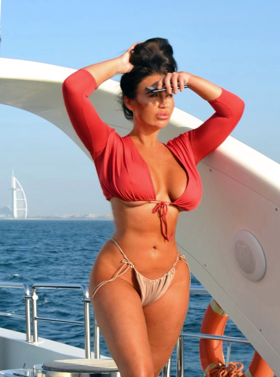 Lauren Goodger flaunts her bum in thong bikini on a luxury yacht in Dubai