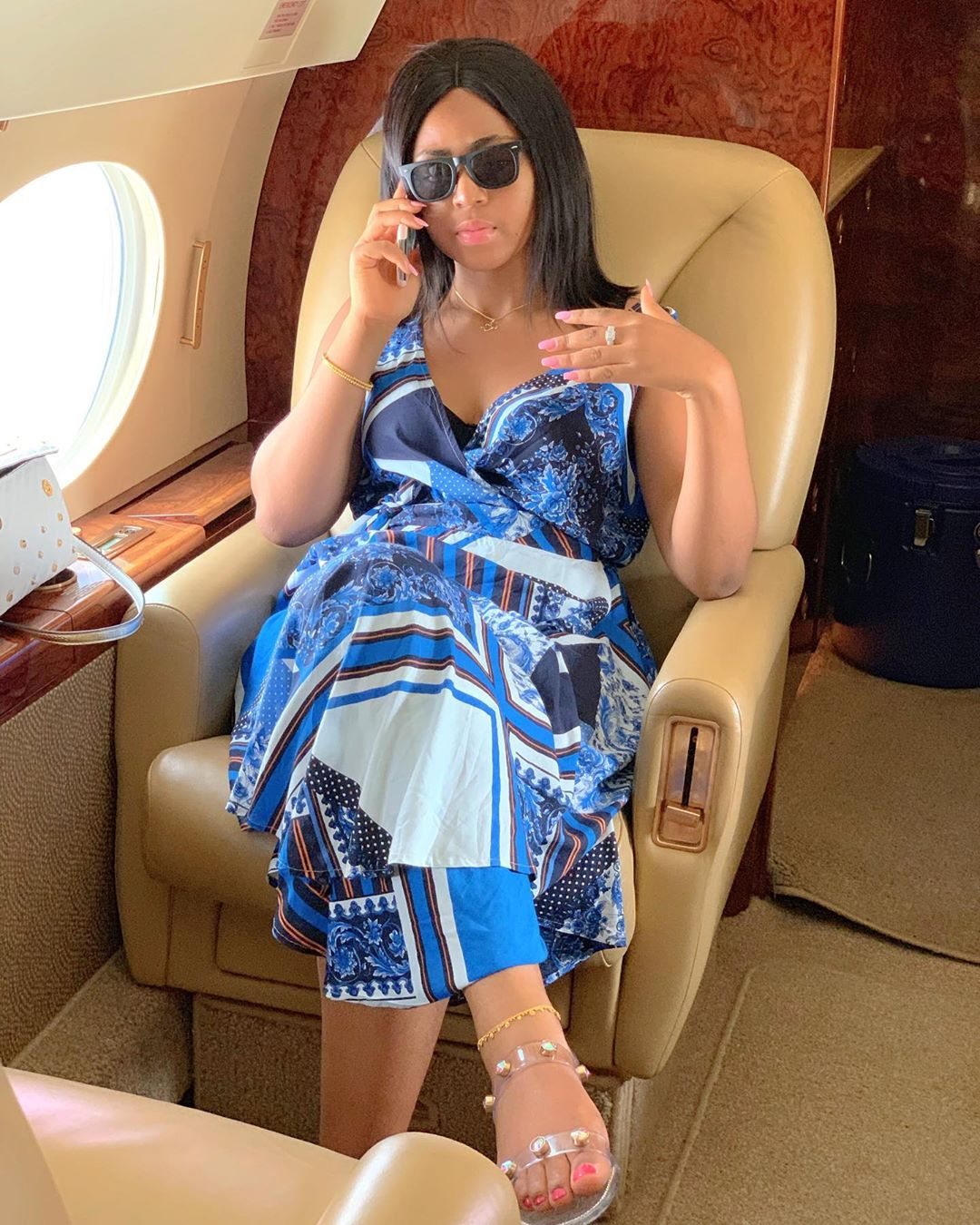 Regina shows off engagement ring in a private jet