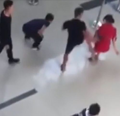 Photo of Moment airline worker is kicked to the ground by drunken man after she refused to pose for a second selfie with him