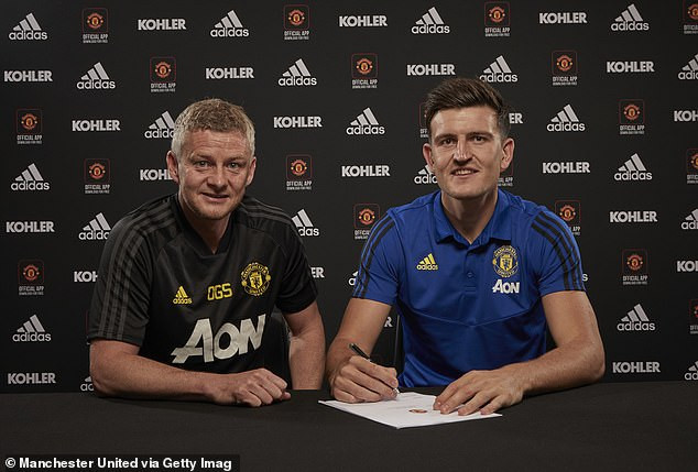 Photo of Manchester United complete record signing of Harry Maguire from Leicester City in £80m move