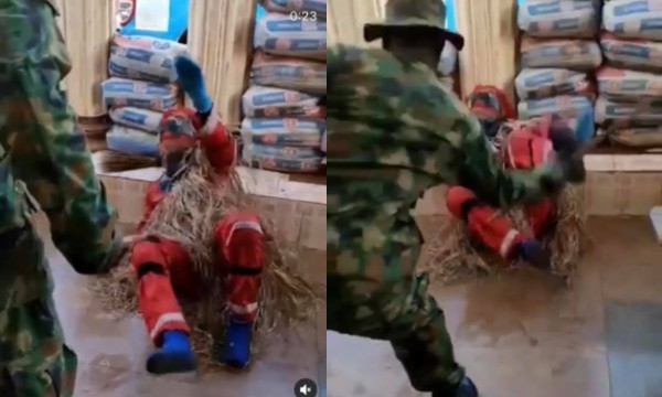 Photo of Masquerade pleads for mercy while being flogged by soldier (video)