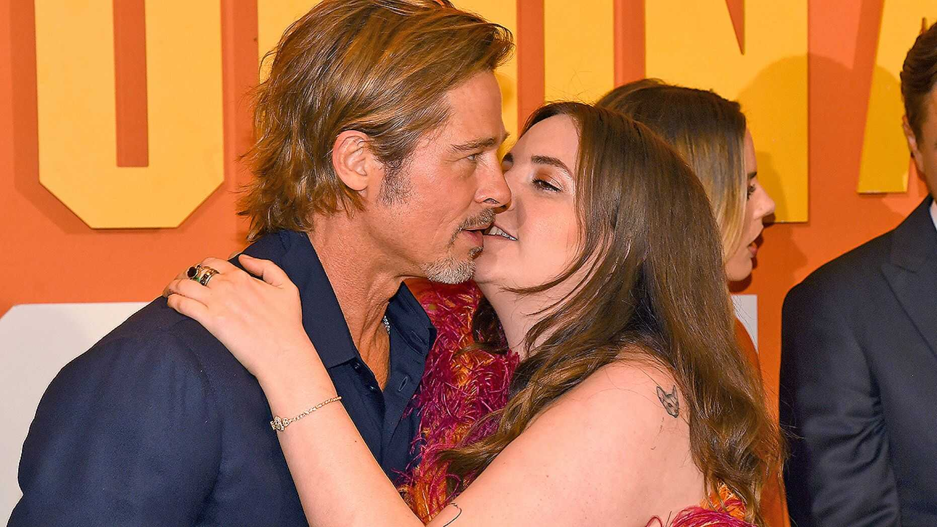 Photo of Lena Dunham awkwardly tries to kiss Brad Pitt at London premiere