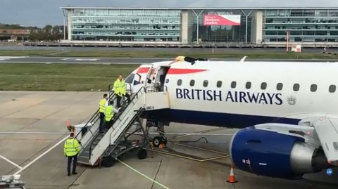 Blind paralympic climbs on top of a plane about to take off