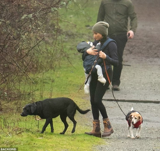 Photo of Meghan Markle threatens lawsuit over photos of her and baby Archie taken while they were hiking in Canada