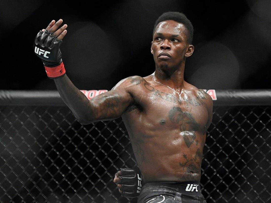 Photo of Nigerian MMA fighter Israel Adesanya defeats Yoel Romero to retain undisputed UFC Middleweight title